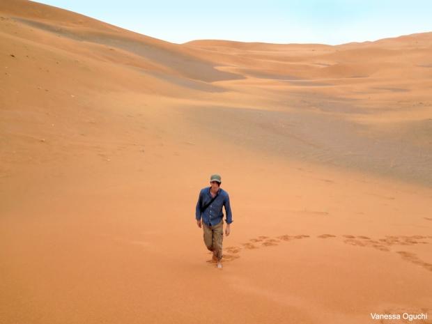 Greg walking up the dune