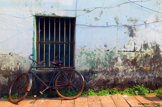 Bike on wall in Old Goa